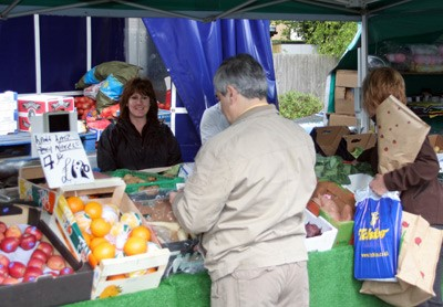 Shoppers at Andy Gardiner's fruit and vegetable stall in Barnet Market
