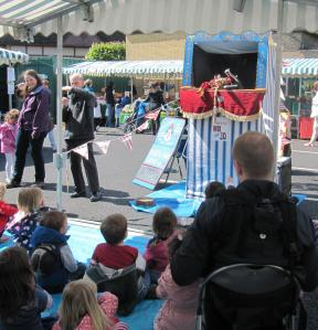 Punch and Judy show entertaining young children in Barnet Market