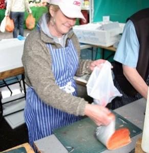 Rita Hammersley, a long time stallholder in Barnet Market, preparing fish
